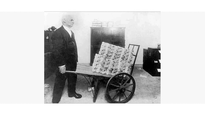 Man with a Wheelbarrow of Money Shows Hyperinflation in Germany